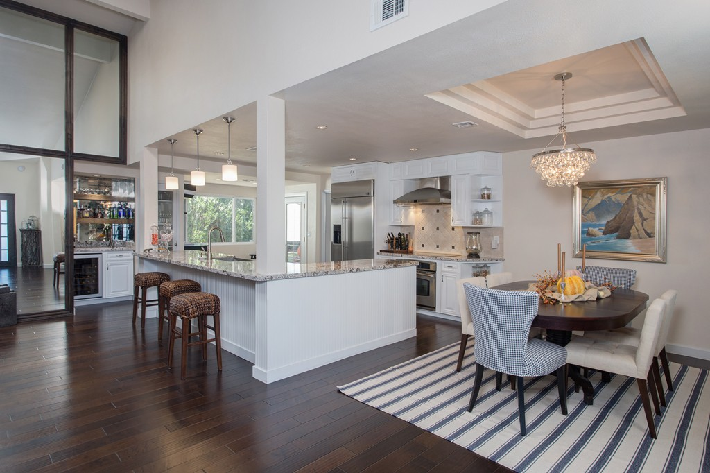 Scottsdale, AZ Kitchen Design & Remodeling with White Cabinets, Granite Countertops and Wood Flooring