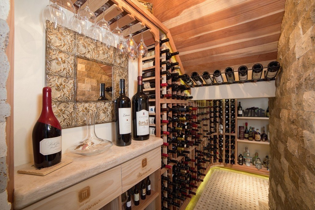 Climate controlled wine cellar constructed in closet located under the stairs. Design & Remodeling by Hochuli